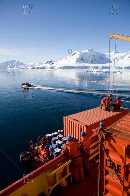 Antarctica, Paradise Bay, Chile - March 21, 2011: Men on a zodiac on Paradise Bay, Antarctica