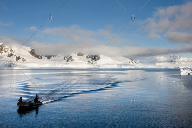 Antarctica, Paradise Bay, Chile - March 21, 2011: Men on a zodiac on Paradise Bay, Antarctica