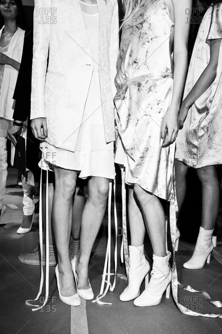 Fashion models waiting backstage at a show