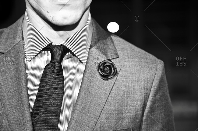 Close up of a rose boutonniere on a man's jacket