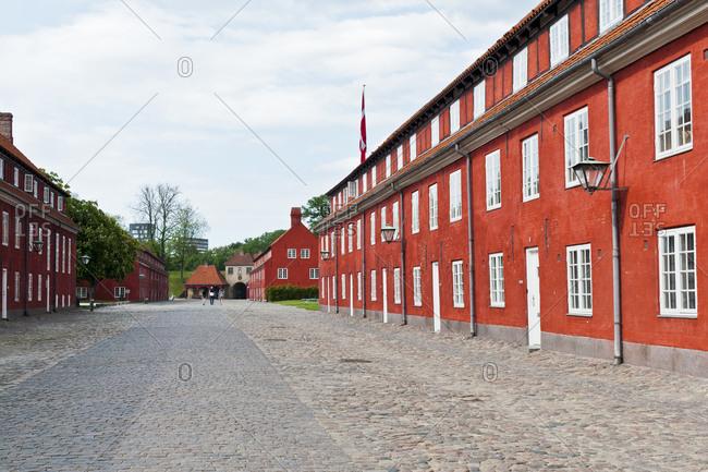 Red brick buildings line a street in Copenhagen