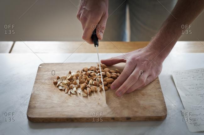 A cook chops almonds