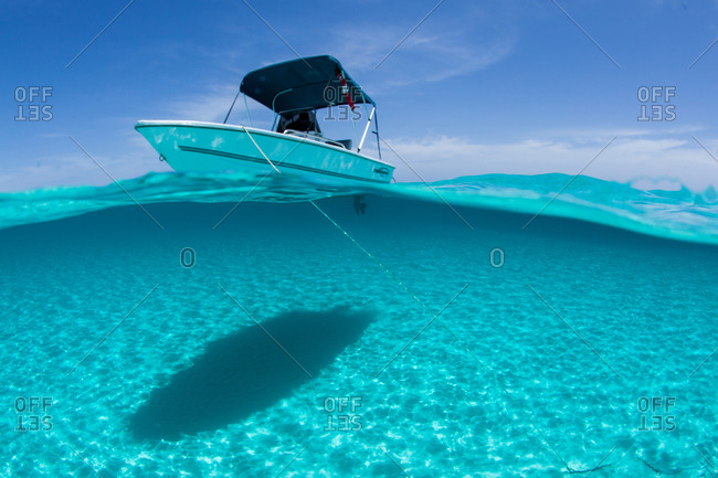 Boat tethered in shallow water