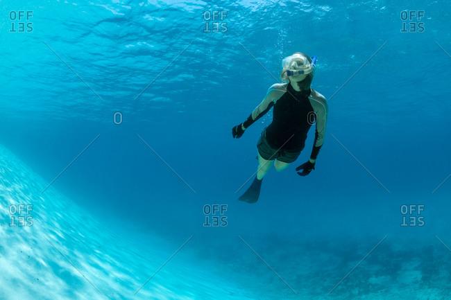 Woman snorkeling near ocean drop off