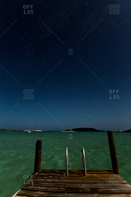 Starry night over Caribbean dock