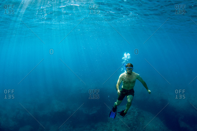 A diver floating in Caribbean water