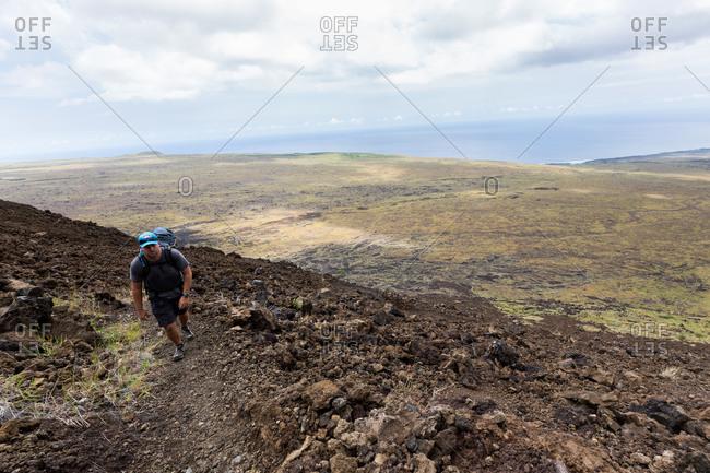 A hiker walking on Big Island, Hawai'i
