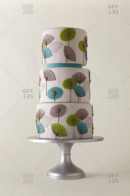 Three-tiered cake decorated with mod dandelions