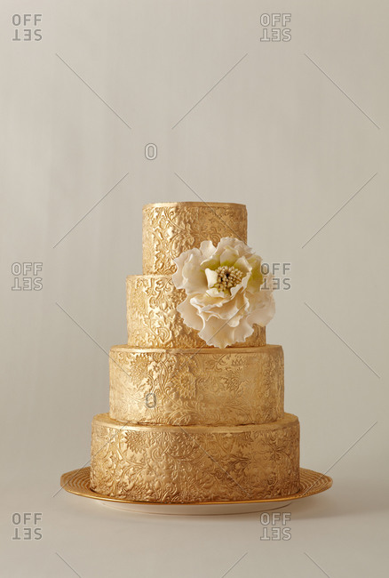 Four tiered gold leaf cake
