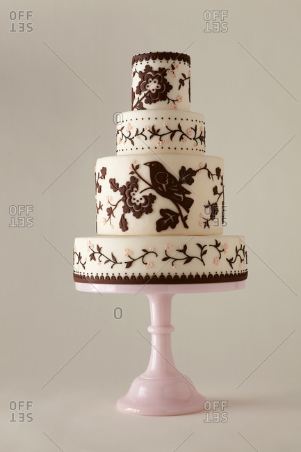 Four-tiered cake decorated with flowers and birds