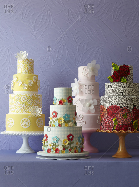 Four cakes sit on a counter