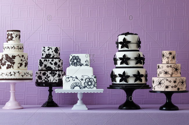 Five cakes on a countertop