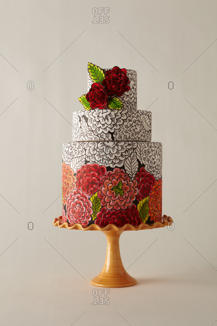 Colorful hand-drawn flowers decorate a cake