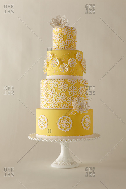 Flower cut outs decorate a four-tiered cake