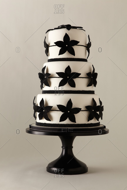 Beaded flowers cover a three-tiered cake