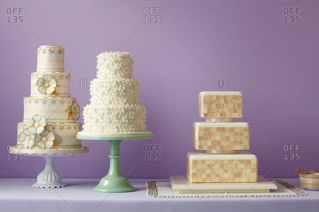 Three cakes sit on a counter