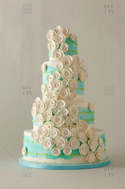 Flowers themed four-tiered cake