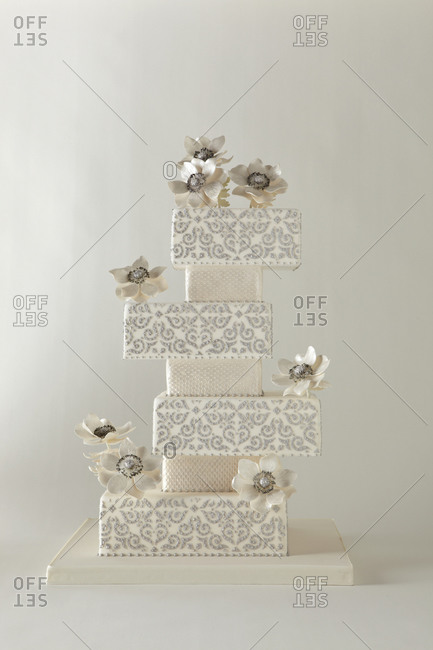 White flowers decorate a multi-tiered cake