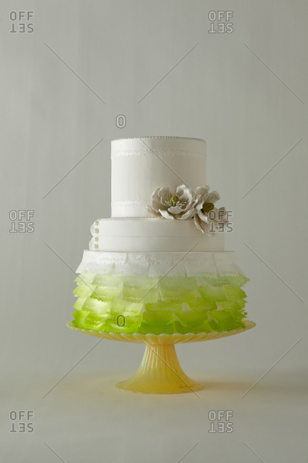 Green ombre flags decorate a three-tiered cake