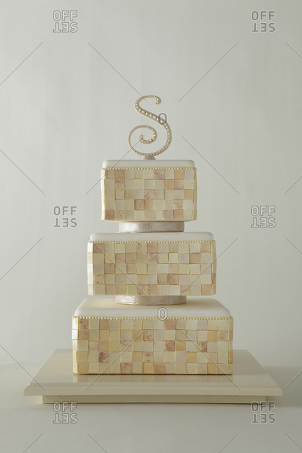 "A ""S"" tops a three-tiered cake"