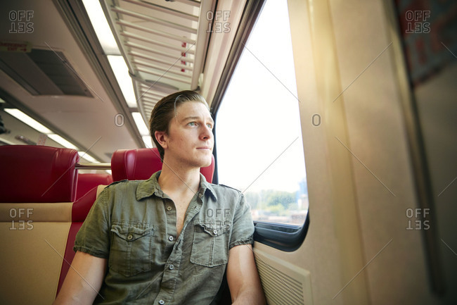 Man staring out of a train window