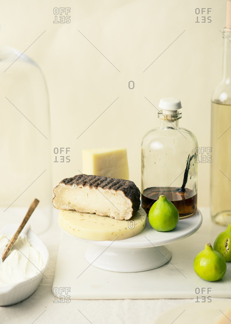 Still life with cheese, maple syrup and figs