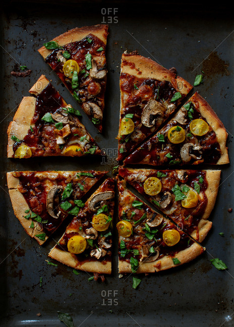 Thin-crust pizza with barbecue sauce topping