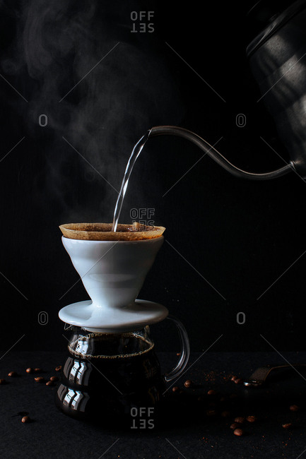 Pouring hot water into a coffeemaker