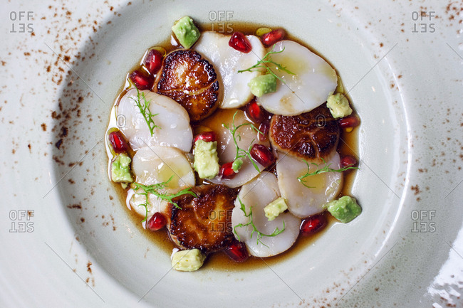 Seared scallops with avocado and pomegranate