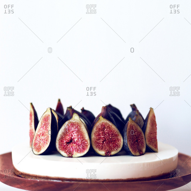 Studio shot of a cheesecake with figs