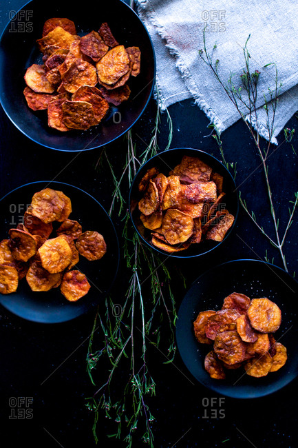 Sweet potato chips with herbs on a table