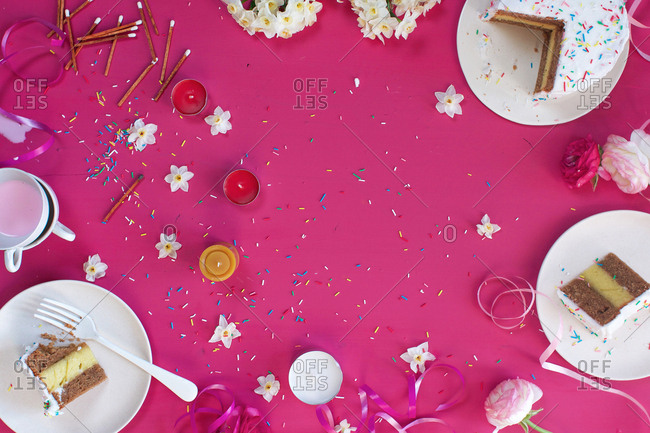 Cakes and decorations on a pink tabletop