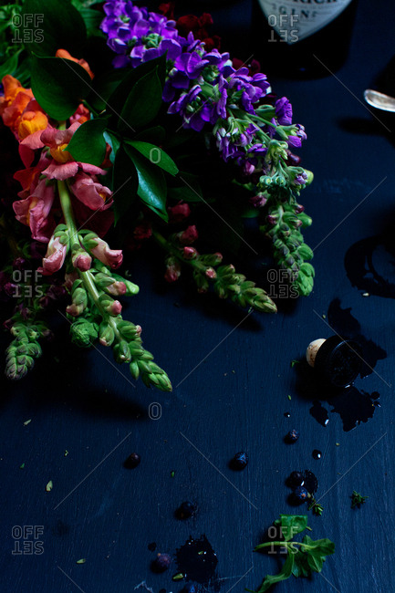 Budding flowers on a messy tabletop