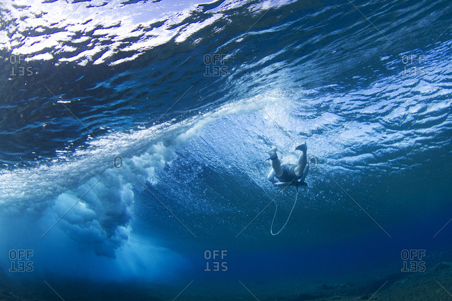 A man rides his surfboard in the ocean
