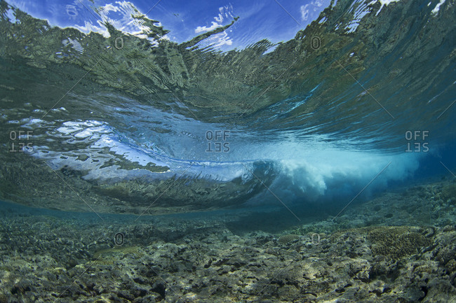 Waves crash below the surface of the water