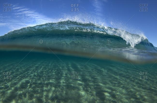 A wave crashes forward