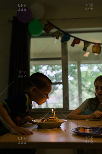 Boy blowing out candles on his cake