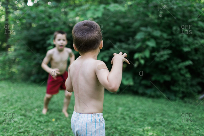 Brothers playing in the garden