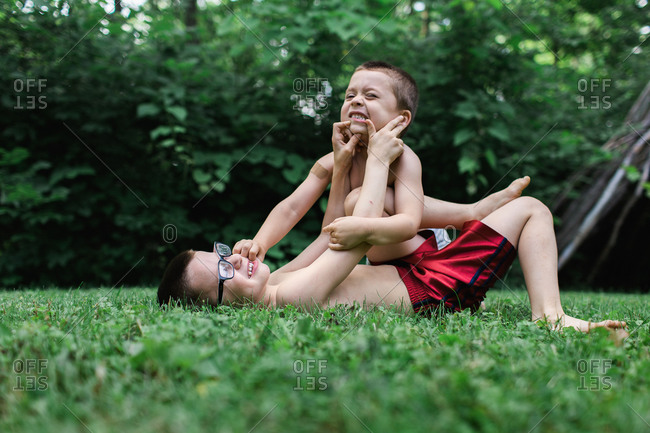 Brothers wrestling in the grass