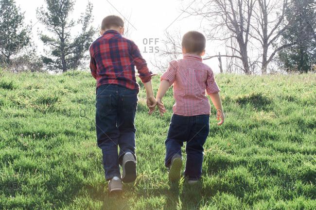 Boys walking up a hill