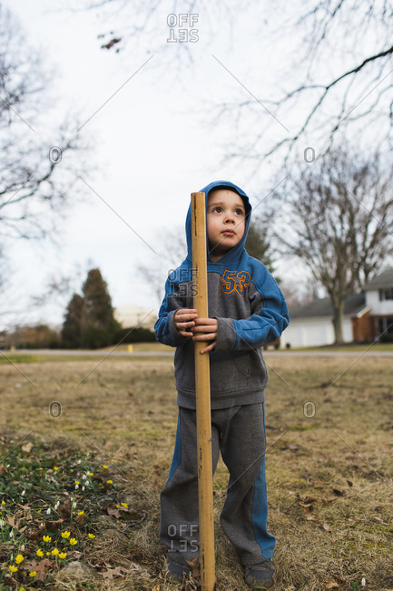 Portrait of a young boy with a shovel