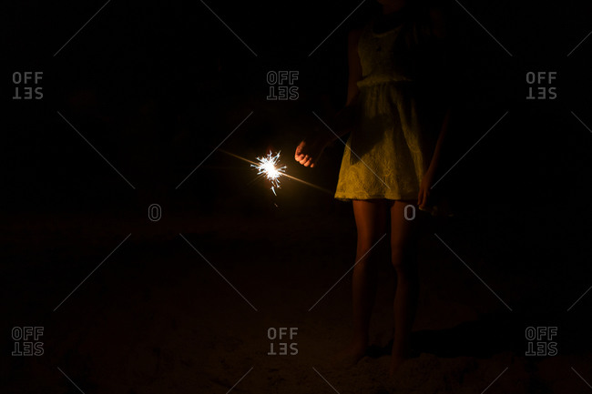 Young girl holding a sparkler