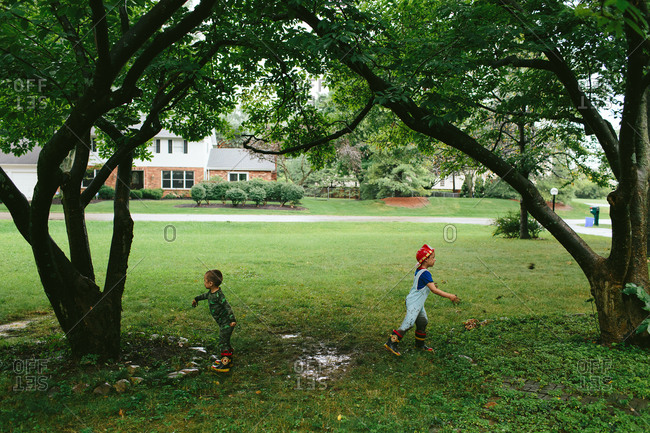Young boys playing in a yard