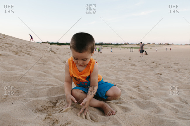 Young boy playing on a sandy beach