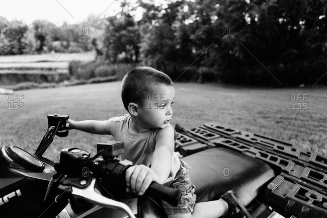 Young boy sitting on four wheeler