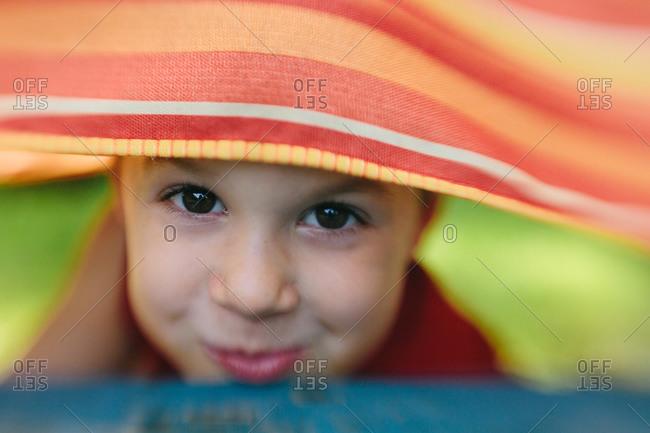 Boy peeking under tablecloth