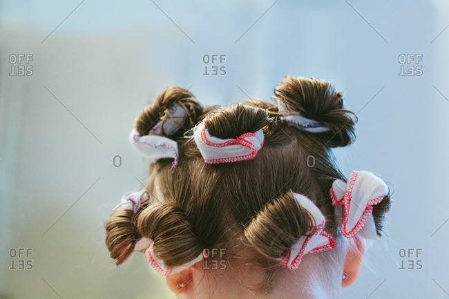Rear view of a girl with rolled hair