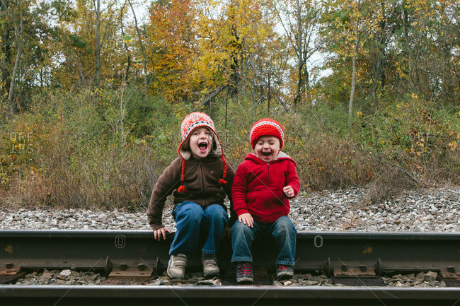 Two boys in hats laughing