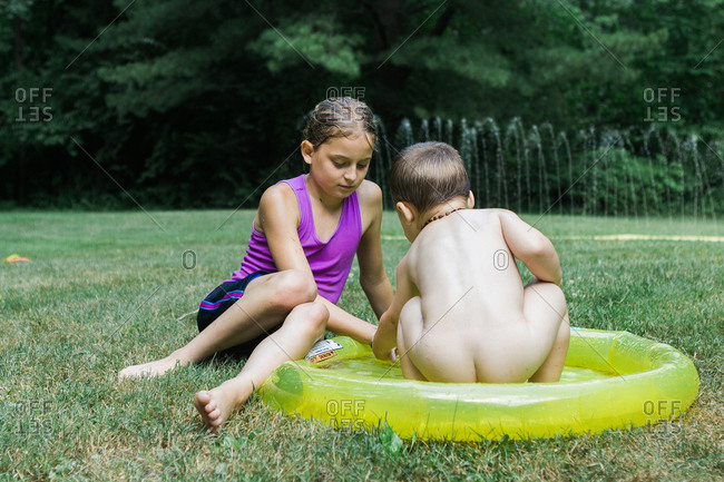 Girl and boy in baby pool