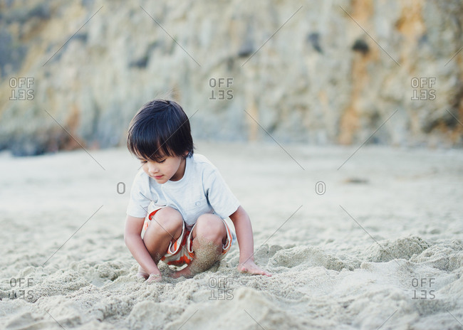 Young boy playing in the sand